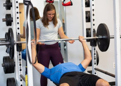 Personal Trainer spotting a man bench pressing