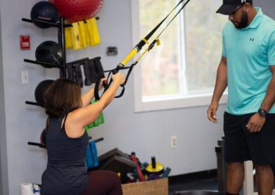 Personal Trainer working with a client on TRX Bands in scarborough maine