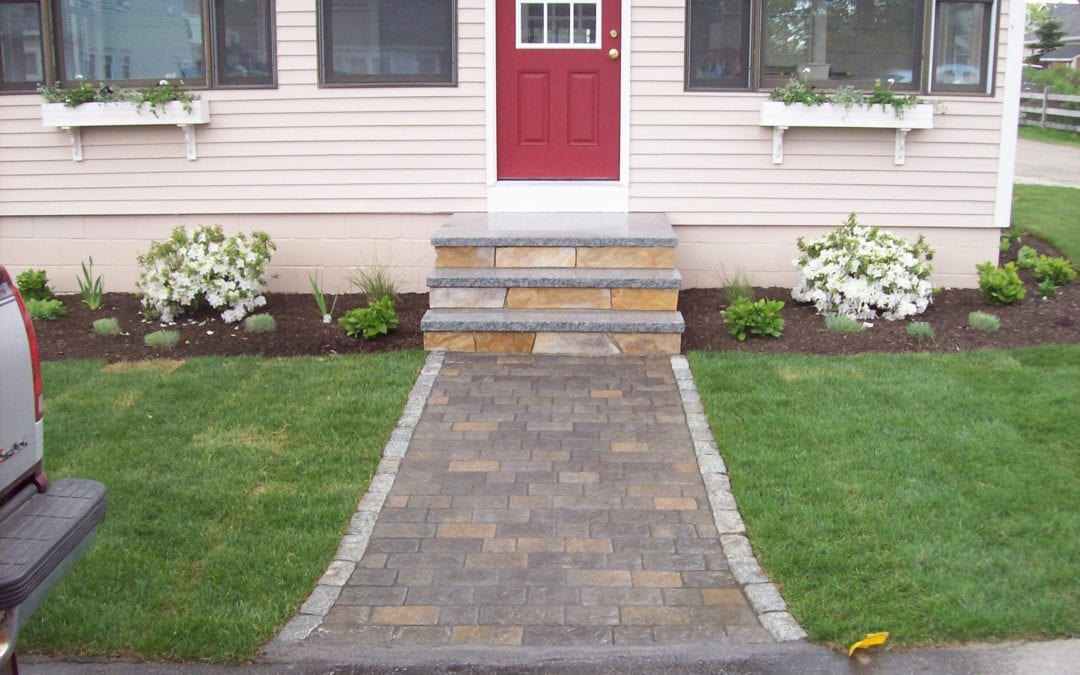 Stone paver walkway with natural stone steps and landscaping