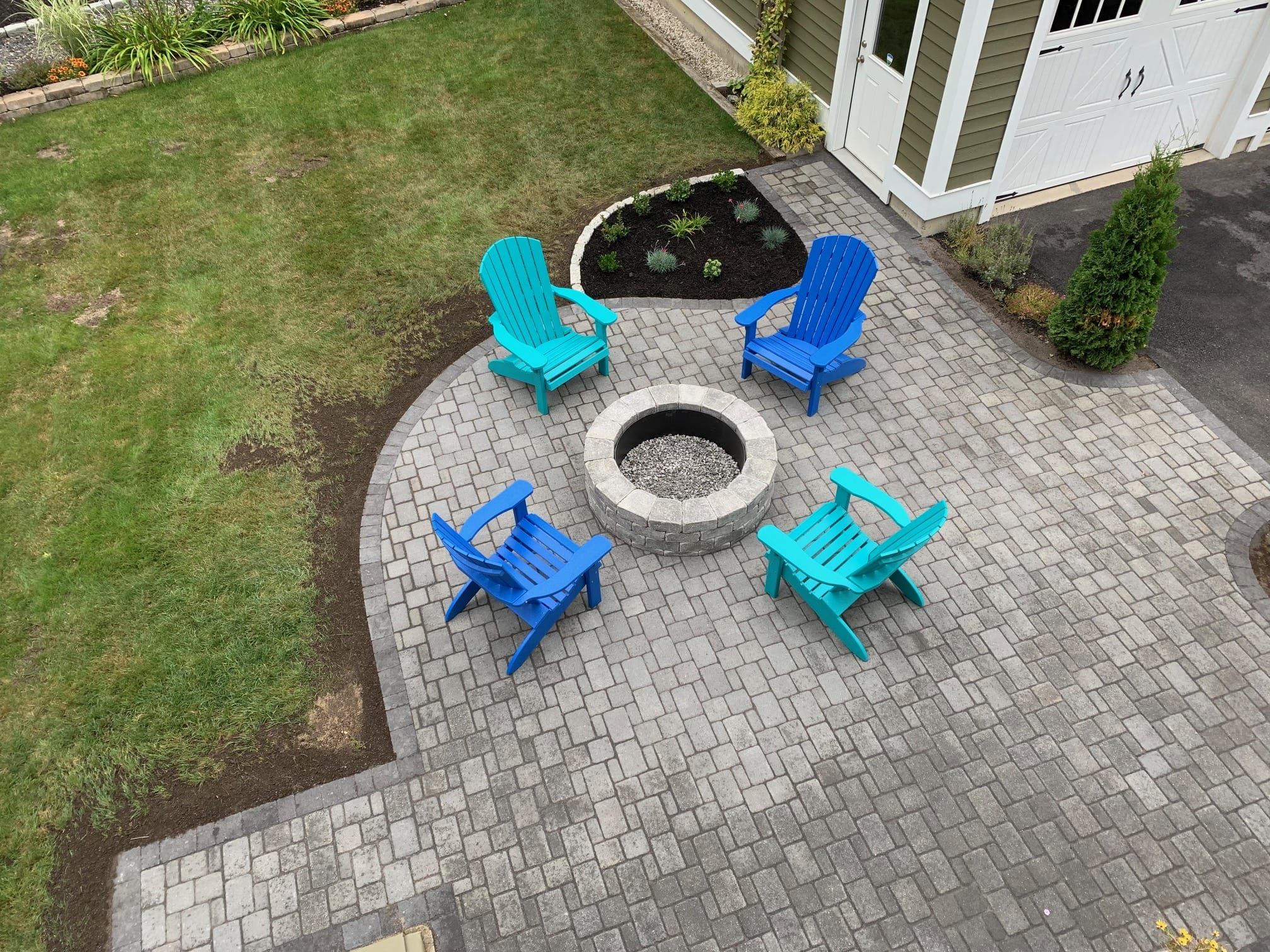 Stone Patio and Fireplace with Adirondack chairs